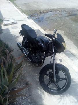 Vendo moto con cauchos nuevos